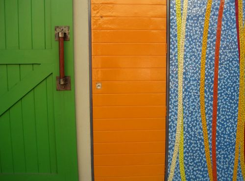 three panels a green door an orange panel