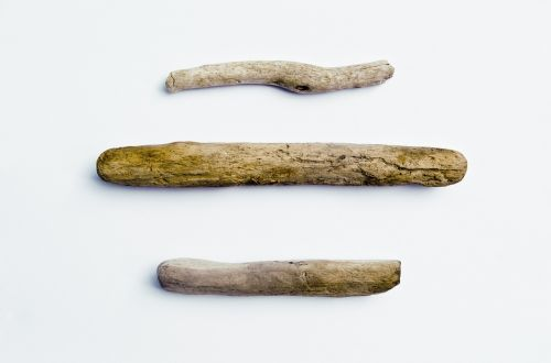 three pieces of driftwood driftwood wood