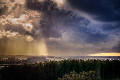 thunderstorm  evening sun  clouds