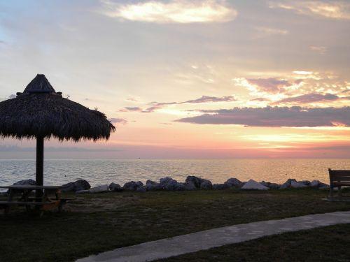 tiki hut at sunset florida keys ocean