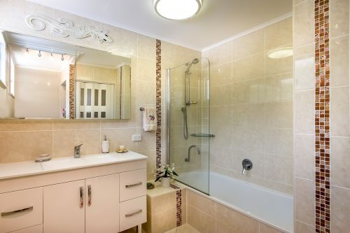 tiled bathroom wall tiles to the ceiling beige tiles