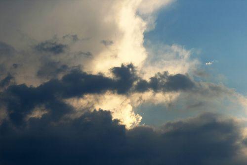 Tinted Clouds Behind Dark Clouds