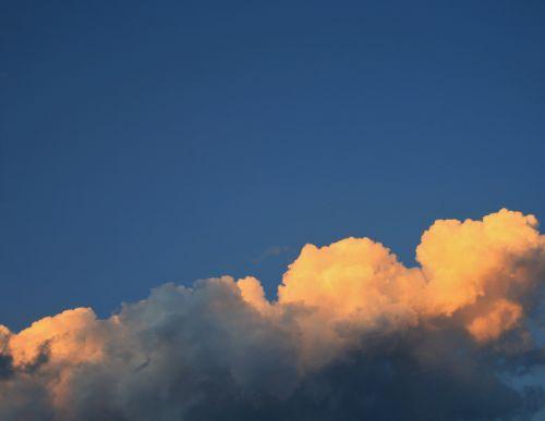 Tinted Cumulus Clouds