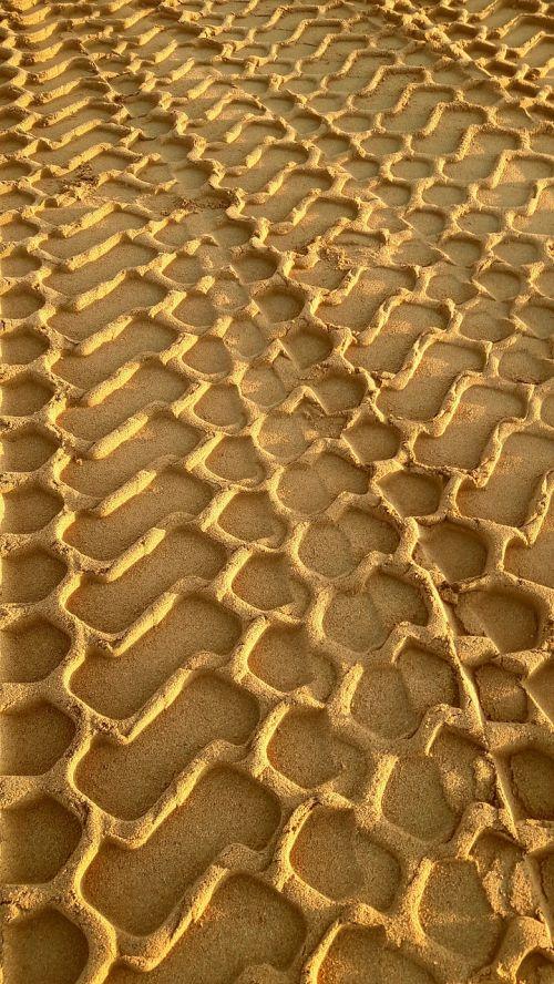tire tracks sand traces