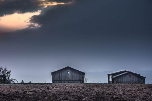 tobacco barns dark sky landscape