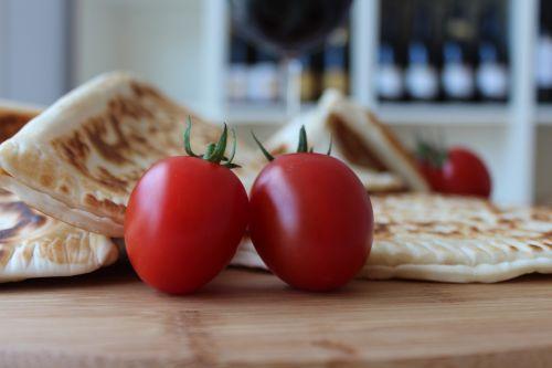 tomatoes watercress chopping board