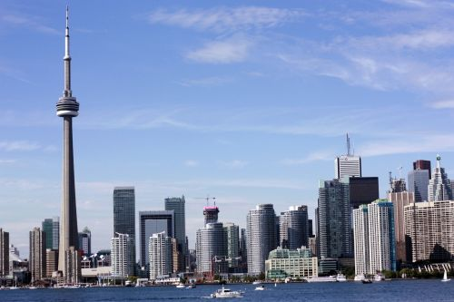 toronto,city,coastal city,tower,cnm tower,water,sea,sky,landscape,cloud,nature,blue sky