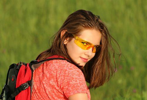 tourist girl backpack