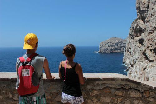 tourists sea cliff