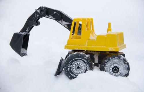 toy excavator snow