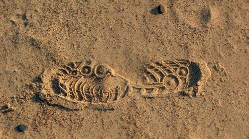 track  imprint  sand