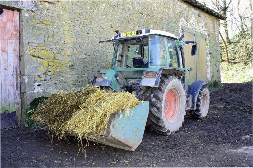 tractor with straw farmyard straw tractor in yard