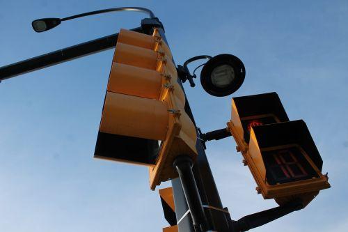 traffic lights road sign street lamp