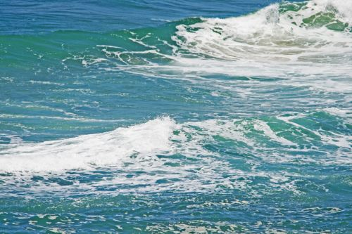Trails Of Foam On Turquoise Swells