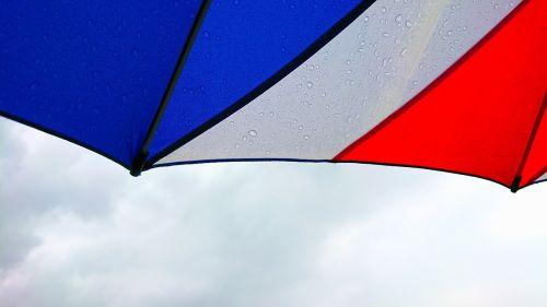tricolor umbrella cloudy
