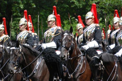 trooping men horses