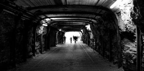 tunnel people silhouettes