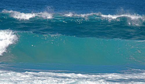 Turquoise Wave Breaking In Ocean