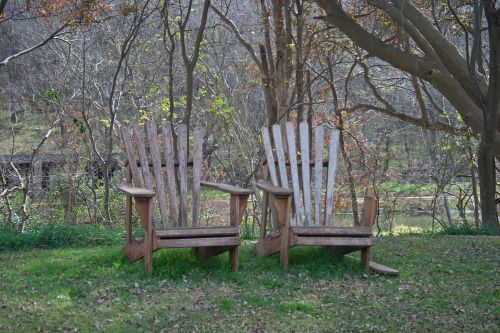 Two Abandoned Wooden Chairs