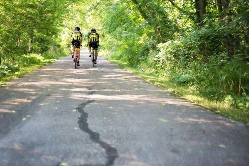 two men on bicycles bike trail biking