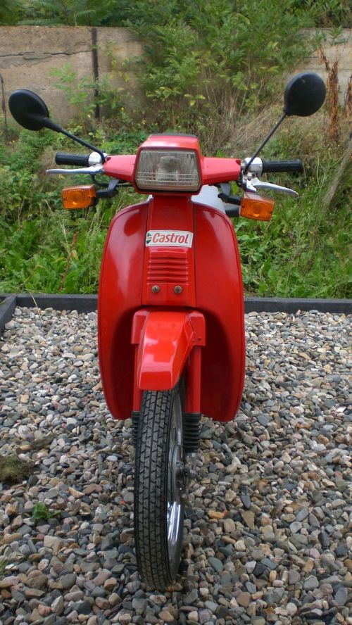 two wheeled vehicle roller red