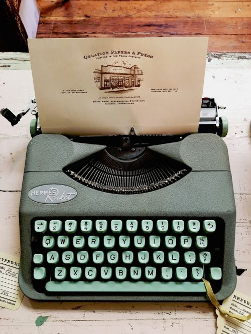 typewriter teal hermes