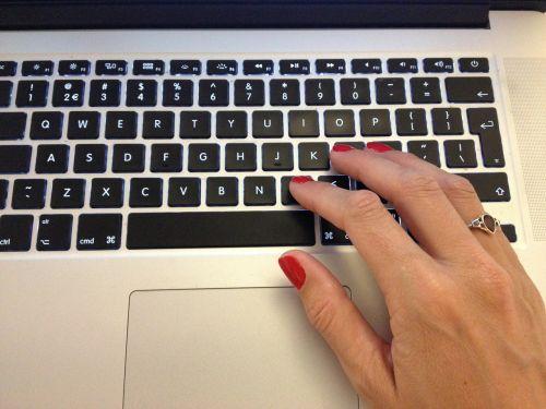 typing laptop computer