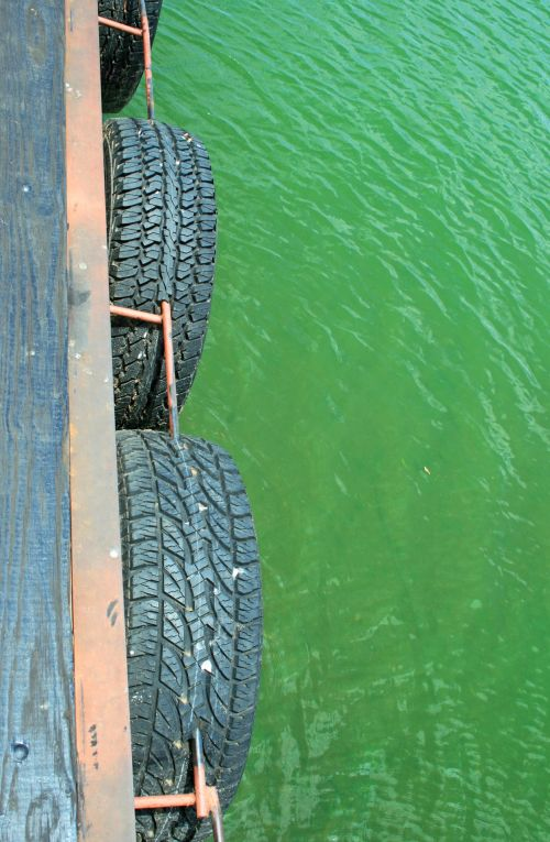 Tyres Of Jetty Over Water