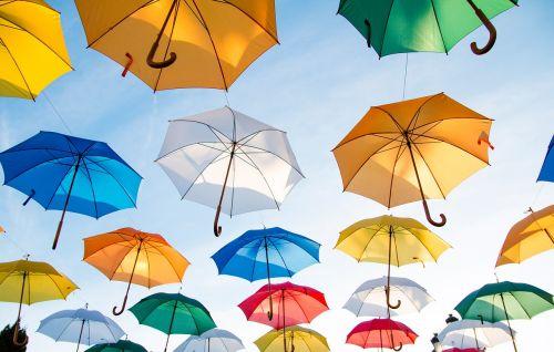 umbrellas sky sunshine