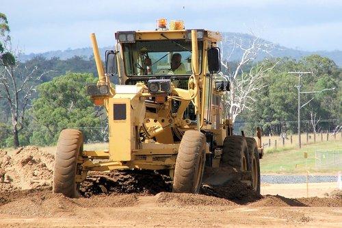 under construction  roadworks  grader