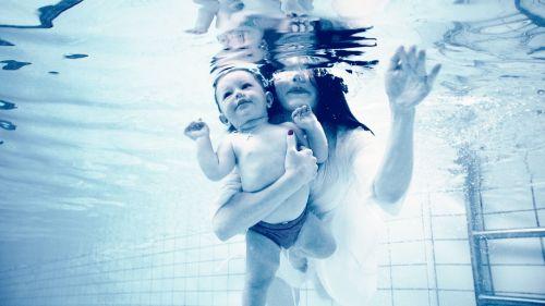 underwater baby mom