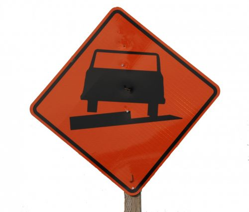 Uneven Pavement Highway Sign