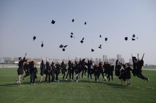 university student graduation jump