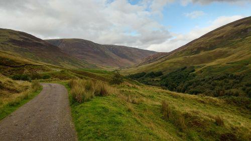 valley winding road scotland