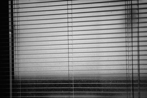 venetian blinds rainy weather dark time