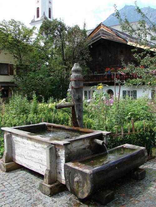 village fountain fountain wood fountain