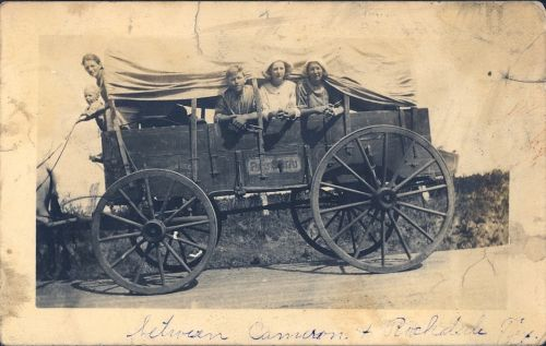 vintage covered wagon family