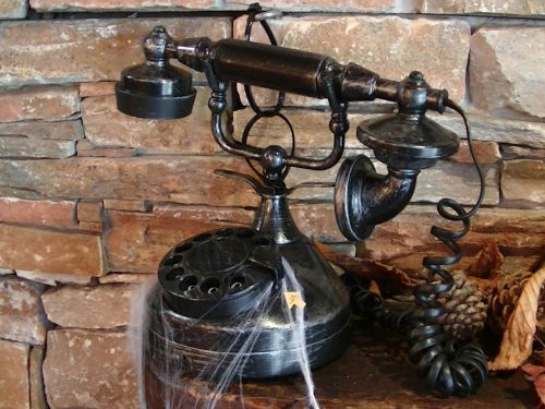 Vintage Telephone With Cobwebs