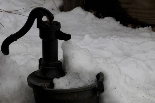 Vintage Water Pump In The Snow