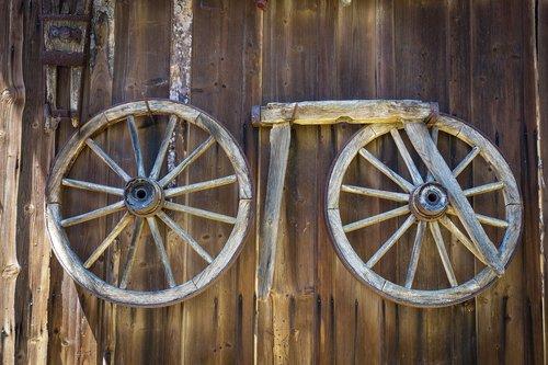 wagon wheel  wood  wooden wall