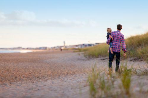 walking beach family