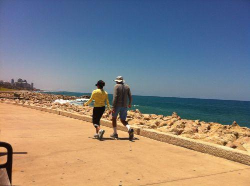 Walking Along The Promenade