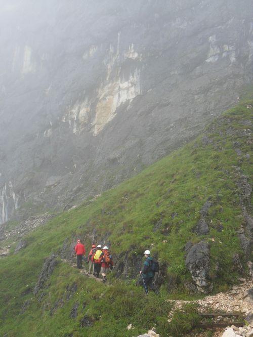 wanderer hiking fog