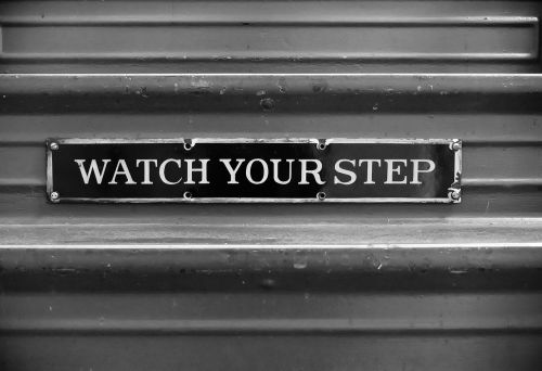 watch your step staircase sign black and white