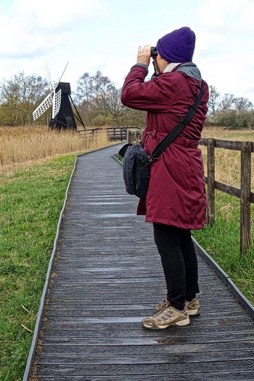 watching looking binoculars