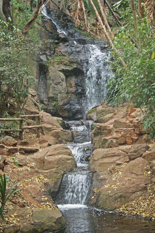 Water Cascading Down Rocks In Tiers