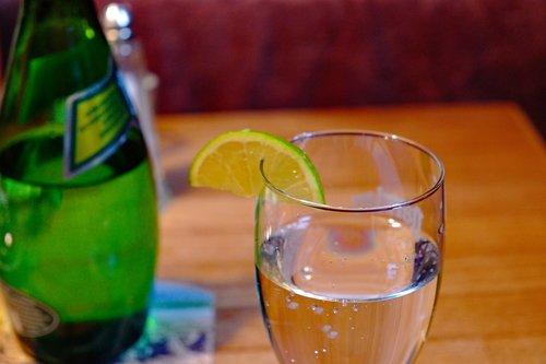 water glass  lemon  mineral water