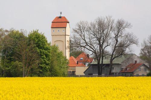 water tower oilseed rape field of rapeseeds