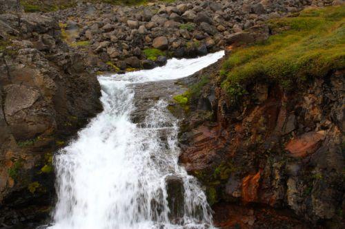 waterfall east iceland rock