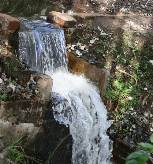 Waterfall With Tiers In Park